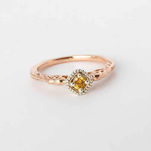 Diamond ring in decorative gold setting